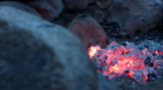 fire camping coals embers
